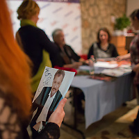 Fan holds a signed photo during an autograph session of US actor John de Lancie (3rd L) held as part of a meeting with his fans in Budapest, Hungary on January 11, 2015. ATTILA VOLGYI