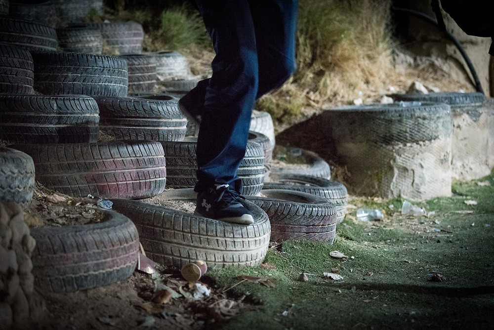 """3 October 2018, Jerusalem, Occupied Palestinian Territories: Though not it's official name, the school in Khan al Ahmar is known as """"the Tire School"""", as a staircase made up of old car tires leads the way to the school building. Khan al Ahmar is a Bedouin community located within the East Jerusalem Periphery, in E1 area. It is home to 32 families, 173 persons in total, including 92 children and youths. The community has a mosque and a school, which was built in 2009 and serves more than 150 children between the ages of six and fifteen, from Khan al Ahmar and other nearby communities. With due date 1 October 2018, Israeli authorities threaten to demolish the site, thereby making room for nearby Israeli settlements to expand."""
