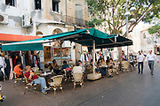 Israel, Tel Aviv, People in an outdoor Cafe in Nachlat Binyamin Street