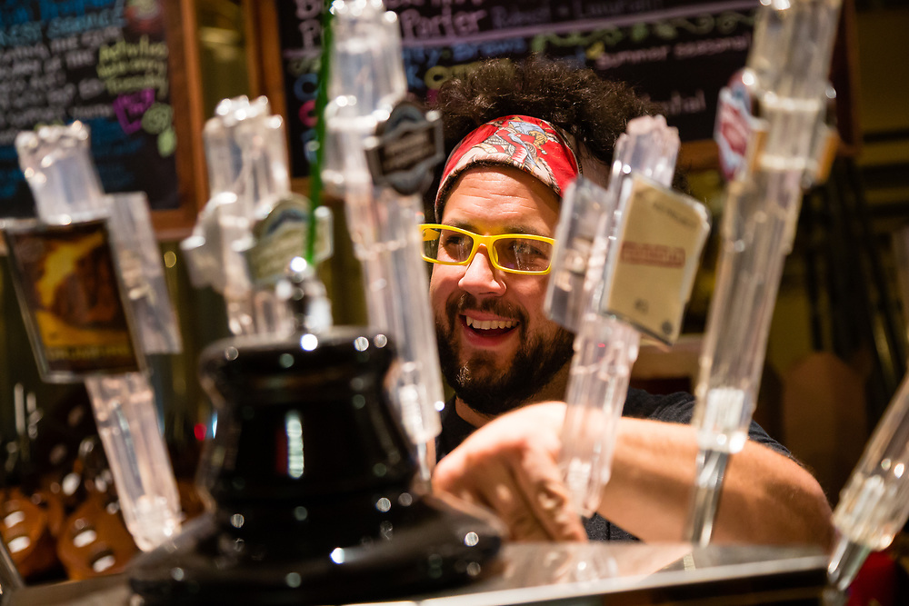 Seth Garrido - Icicle Brewery Barkeep pours beers for tired mountain bikers.
