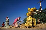 Local tribeswomen building a road through the Thar desert
