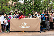 Visitors wait in line to enter Walt Disney Co.s Shanghai Disneyland theme park during a trial run ahead of its official opening, in Shanghai, China, on Wednesday, June 8, 2016. The $5.5 billion Shanghai Disneyland is one  of the most profitable Disney ventures in the world and the first theme park on mainland China.