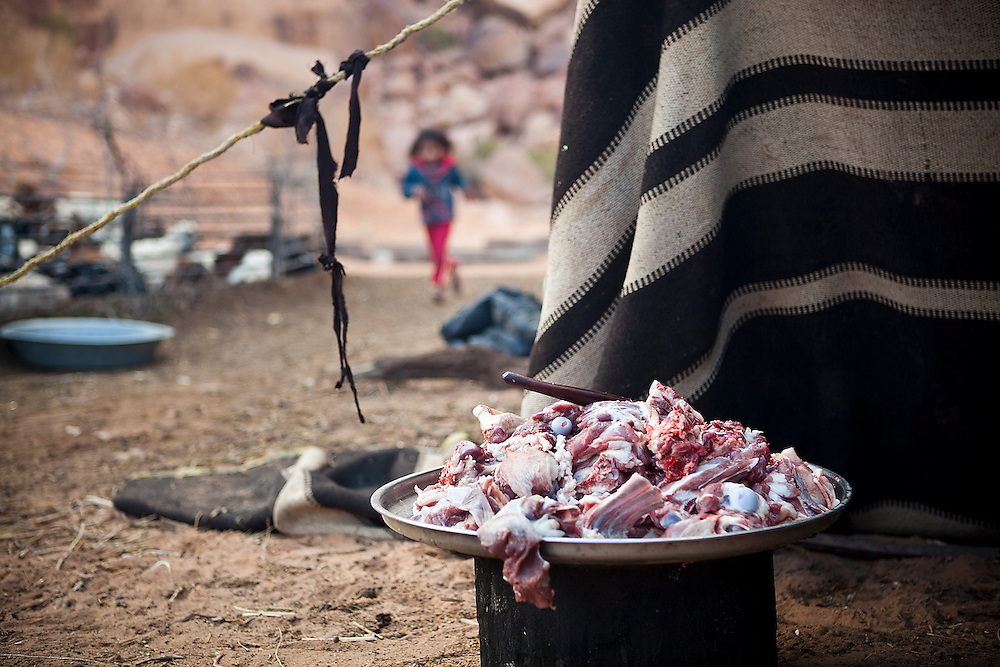 A platter of chopped goat meat for mansaf, a local delicacy of goat roasted in yogurt, at a Bedouin encampment in Wadi Rum, Jordan.