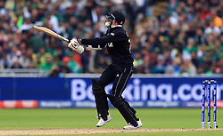 New Zealand's Mitchell Santner gets hit in the helmet as he bats during the ICC Cricket World Cup group stage match at Edgbaston, Birmingham.