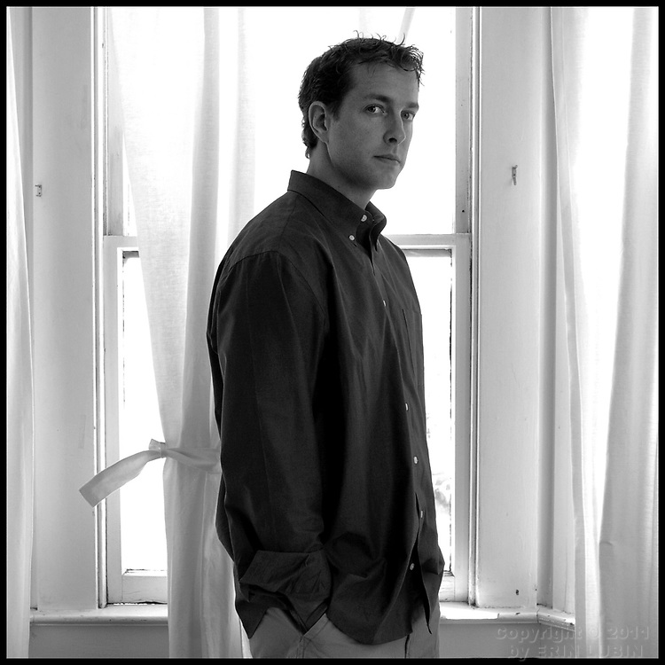 Chris Pitkin, whose father committed suicide in 2003, stands near a window in his San Francisco home on July 9, 2006...Pitkin was one of thousands of Bay Area Residents who participated in the American Foundation for Suicide Prevention annual fundraising walk, Out of the Darkness, in San Francisco, CA on July 22, 2006...Photo by Erin Lubin