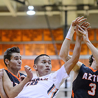 Gallup Bengal Nate Joh (10) knocks the ball away from Aztec Tiger Lindsey Larabee (3) Friday at Gallup High School.