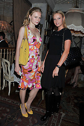 Left to right, KATIA ELIZAROVA and DASHA ZHAROVA at an afternoon tea party in aid of the Naked Heart Foundation held at Mari Vanna, Wellington Court, 116 Knightsbridge, London on 29th August 2012.