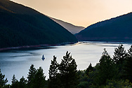 A sailboat glides along Reudi Reservoir as the sun sets in Pitkin County, Colorado.