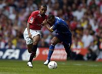 Photo: Richard Lane.Digitalsport<br /> Arsenal v Manchester United. FA Community Shield. 08/08/2004.<br /> David Bellion and Ashley Cole battle for the ball.