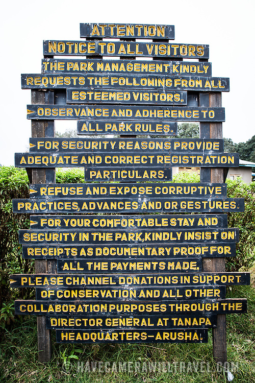 Signs giving various directions at Londorossi Gate, one of the National Park ranger gates to Kilimanjaro National Park, and the gate one must check in to when climbing the Lemosho Route of Mount Kilimanjaro.