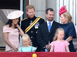 Prince Harry, Meghan Duchess of Sussex, Peter Phillips, Autumn Phillips and Savanna Phillips on the balcony of Buckingham Palace at Trooping The Colour, London. Photo credit should read: Doug Peters/EMPICS