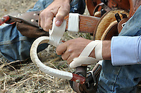 John Redig of Casper, Wyoming takes care with every surface of his gear during preparations for Friday night's events at the 2013 California Rodeo Salinas.