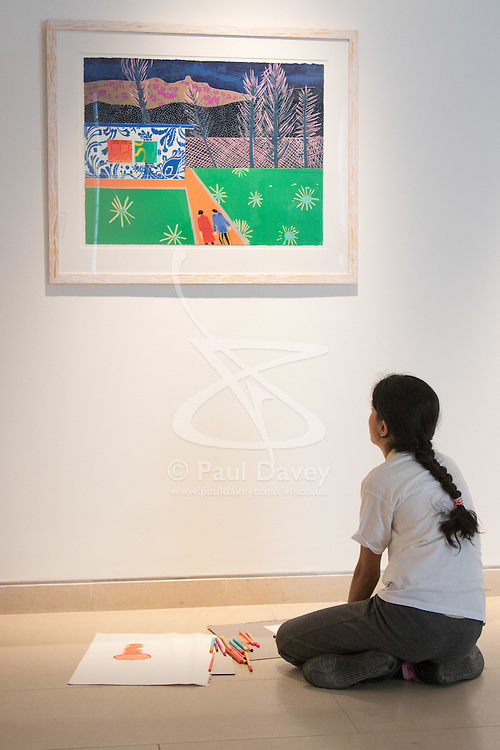 "Christies, St James, London, March 4th 2016. A girl from Charlton Manor Primary School admires  Tom Hammick's reduction woodcut ""Trailer"" created in 2014, at the preview for the It's Our World charity auction at Christie's. Over 40 leading artists including David Hockney, Sir Antony Gormley, David Nash, Sir Peter Blake, Yinka Shonibare, Sir Quentin Blake, Emily Young and Maggi Hambling have committed artworks to the It's Our World Auction in support of The Big Draw and Jupiter Artland Foundation, to be sold at Christie's London on 10 March 2016.<br />  ///FOR LICENCING CONTACT: paul@pauldaveycreative.co.uk TEL:+44 (0) 7966 016 296 or +44 (0) 20 8969 6875. ©2015 Paul R Davey. All rights reserved."