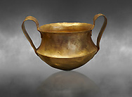 Two handled Mycenaean gold bowl cup from the Kakovatos tholos tomb, Trifylia, Greece. National Archaeological Museum Athens.  Grey art Background <br /> <br /> Kakovatos is a significant site of the early Mycenaean period of Greece (c. 16th to 15th century BC) on the west coast of the Peloponnese (Zacharo, Nomos Elis) and became widely known through the excavations of three large tholos tombs by Wilhelm Dörpfeld in 1907–1908. .<br /> <br /> If you prefer to buy from our ALAMY PHOTO LIBRARY  Collection visit : https://www.alamy.com/portfolio/paul-williams-funkystock/mycenaean-art-artefacts.html . Type -   Athens    - into the LOWER SEARCH WITHIN GALLERY box. Refine search by adding background colour, place, museum etc<br /> <br /> Visit our MYCENAEN ART PHOTO COLLECTIONS for more photos to download  as wall art prints https://funkystock.photoshelter.com/gallery-collection/Pictures-Images-of-Ancient-Mycenaean-Art-Artefacts-Archaeology-Sites/C0000xRC5WLQcbhQ