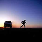 A U.S. Border Patrol vehicle chases an undocumented immigrant who had just entered the United States illegally. Please contact Todd Bigelow directly with your licensing requests. PLEASE CONTACT TODD BIGELOW DIRECTLY WITH YOUR LICENSING REQUEST. THANK YOU!