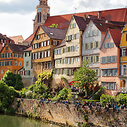Students and tourists enjoying the weather and picturesque architecture of Tübingen, Germany. <br /> <br /> Tübingen is best described as a mixture of old and distinguished academic flair, including liberal and green politics on the one hand and traditional German-style student fraternities on the other, with rural-agricultural environs and shaped by typical Lutheran-Pietist characteristics, such as austerity and a Protestant work ethic, and traditional Swabian elements, such as frugality, order and tidiness. The city is home to many picturesque buildings from previous centuries and lies on the river Neckar.<br /> <br /> According to a national survey, Tübingen has the highest quality of life of all cities in Germany.