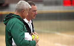 30 March 2013:  Titan coaches Graham Arnold and Steve King during an NCAA Division III women's softball game between the DePauw Tigers and the Illinois Wesleyan Titans in Bloomington IL