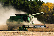 A combine harvests soybeans on a beautiful autumn day in rural Sauk County, Wisconsin.