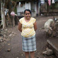"""Jesus, Survivor of Domestic Violence<br /> <br /> María de Jesús Gabarette, Tierra Colorada, Lempira<br /> <br /> <br /> """"My husband died. He hanged himself, here in the house, with a rope. He was a drunk. When he used to get drunk I'd be afraid. He'd be really drunk sometimes and he'd shout at me, telling me off for going to church. Sometimes I'd just leave the house and sleep somewhere else, or I'd sleep with a knife under my pillow. Everyone used to tell me to leave him. Since he's died, it's helped me going to the church. My children helped me build this little adobe house.<br /> <br /> He's been dead seven years now. Lots of women get killed by drunk and violent husbands.<br /> <br /> I'm afraid my kids will waste their lives drinking.<br /> <br /> I make a living by going to Lepaera to buy vegetables and chickens, and I bring them back here to sell. And I'm training to be a midwife. I had my first baby at 24, here in the house, attended by a midwife."""""""