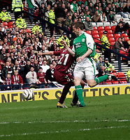 Hearts Michal Pospisil(L) is brought down in the box by Hibs Gary Smith(R) giving Hearts a penalty. Photo: Tom Ross.<br />
