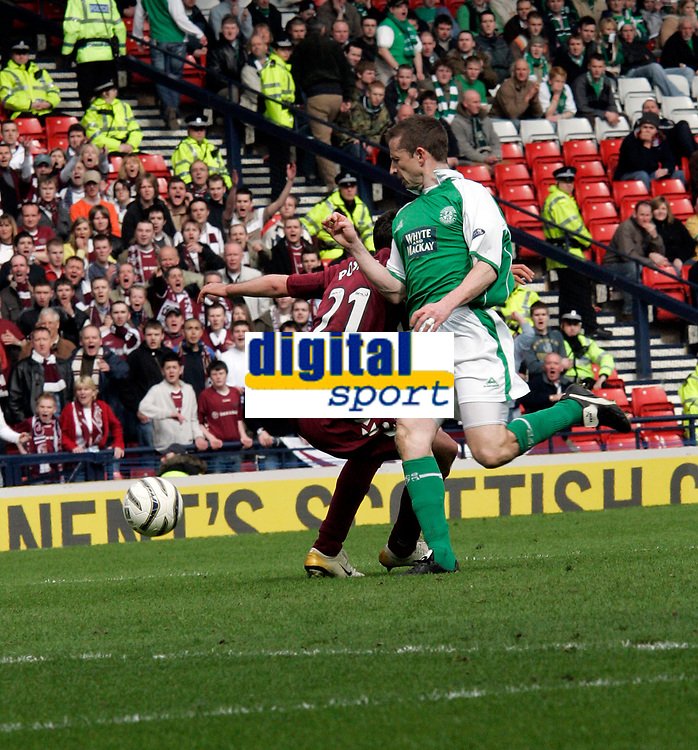 Hearts Michal Pospisil(L) is brought down in the box by Hibs Gary Smith(R) giving Hearts a penalty. Photo: Tom Ross.<br />Hibernian v Hearts. Tennants Scottish Cup, Semi-Final. 02/04/2006.