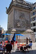 In the week that many more Londoners returned to their office workplaces after the Covid pandemic, workers enjoy after-hours drinks beneath the historic 'Monument' in the City of London, the capital's financial district, on 8th September 2021, in London, England. Monument marks the approximate location where where the Great Fire of London is said to have started in 1666.