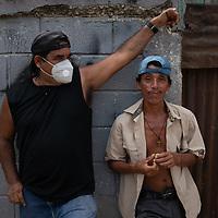 Two men in Chamelecón, San Pedro Sula, Honduras