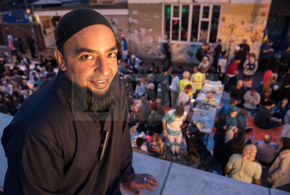 © Licensed to London News Pictures. 07/06/2018. Bristol, UK. ABBID HUSSAIN, Secretary of the Easton Jamia Mosque, at the Grand Iftar Ramadan celebration meal. One of the biggest street parties in the UK is held in Bristol and everyone and anyone is invited. Over 1000 people attended Easton Jamia Mosque's Grand Iftar celebration in St Marks Road, organised to give the the local Muslim community the opportunity break bread with their wider community during Ramadan. Festivities included a feast with food handed out to everyone by the muslim community, as well as an opportunity to meet people from all walks of life. Similar events across the country are held to promote and celebrate unity within the community, giving people the chance to come along and learn about the significance of Ramadan within the Islamic faith. Members of the public of all faiths, ethnicities and areas of Bristol were welcomed at the evening. Photo credit: Simon Chapman/LNP