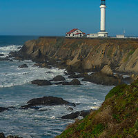 A lighthouse warns ships away from rocks off Point Arena on the California coast.