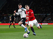 Luke Shaw of Manchester United runs past Jason Knight of Derby County during the FA Cup match at the Pride Park Stadium, Derby. Picture date: 5th March 2020. Picture credit should read: Darren Staples/Sportimage