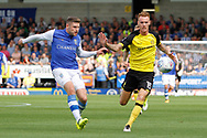 Sheffield Wednesday striker Gary Hooper (14) and Burton Albion defender Tom Naylor (15) during the EFL Sky Bet Championship match between Burton Albion and Sheffield Wednesday at the Pirelli Stadium, Burton upon Trent, England on 26 August 2017. Photo by Richard Holmes.