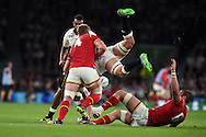 Tom Wood of England is upended in a tackle from Bradley Davies of Wales.  Rugby World Cup 2015 pool A match, England v Wales at Twickenham Stadium in London, England  on Saturday 26th September 2015.<br /> pic by  Andrew Orchard, Andrew Orchard sports photography.