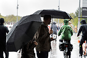 people walking and cycling during a rainstorm Amsterdam