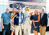 Garden City, New York, U.S. July 20, 2019. L-R, ALAN CONTESSA, Nassau County Executive LAURA CURRAN, ERNEST FINAMORE, (wearing space suit) TOM RUHLE, visitor SUE MOLLER holding child looking up at astronaut helmet, and Suffolk County Executive STEVE BELLONE, pose in front of stage at the Moon Fest Apollo at 50 Countdown Celebration at Cradle of Aviation Museum in Long Island, held during the same time Apollo 11 Lunar Module landed on the Moon 50 years ago.