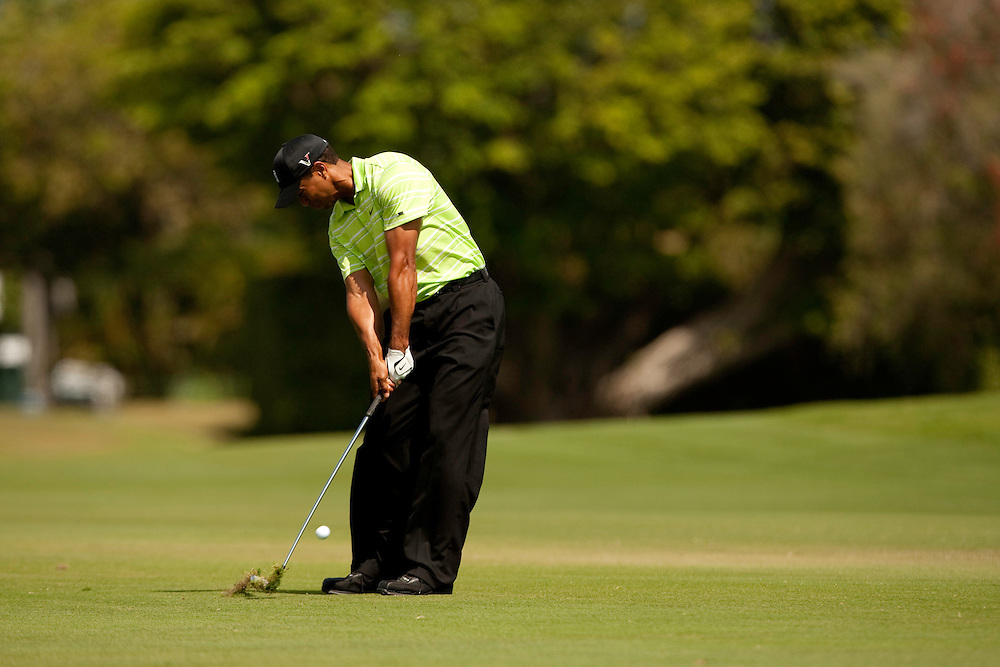 DORAL, FL - MARCH 14:  Tiger Woods hits his shot during the third round of the 2009 WGC-CA Championship at Doral Golf Resort and Spa in Doral, Florida on Saturday, March 14, 2009. (Photograph by Darren Carroll) *** Local Caption *** Tiger Woods