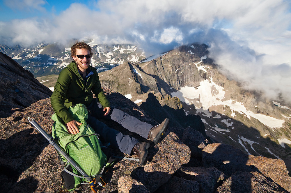 James Meldrum relaxes on the summit of Longs Peak, Rocky Mountain National Park, Colorado. Chiefs Head is visible in the background.