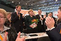 09 DEC 2014, KOELN/GERMANY:<br /> Vincent Kokert (L), CDU, Generalsekretaer der CDU MEcklenburg-Vorpommern, Angela Merkel (M), CDU, Bundeskanzlerin, und Lorenz Caffier (R), CDU Landesvorsitzender und Innenminister Mecklenburg-Vorpommern, nach der Bekanntgabe des Wahlergebnisses ihrer Wiederwahl zur Bundesvorsitzenden der CDU, CDU Bundesparteitag, Messe Koeln<br /> IMAGE: 20141209-01-104<br /> KEYWORDS: Wahl, Wahlergebnis, Party Congress, Applaus, applaudieren, klatschen