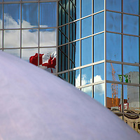 North America, Canada, Nova Scotia, Halifax. Architectural reflections of Canadian Flag  beyond wave sculpture.