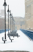 Snow falls on the Pont de Rennes Pedestrian Bridge in th Upper Falls section of Rochester, New York.