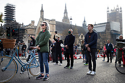 © Licensed to London News Pictures. 08/11/2020. London, UK. Members of the public take part in a minute's silence in Parliament Square as part of Remembrance Sunday .  Photo credit: George Cracknell Wright/LNP