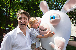 Hadrian Trudeau hugs a rabbit while in the arms of his father, Prime Minister Justin Trudeau at a street party for the Fete National du Quebec, Saturday, June 24, 2017 in Montreal, Canada. Photo by Paul Chiasson/CP/ABACAPRESS.COM