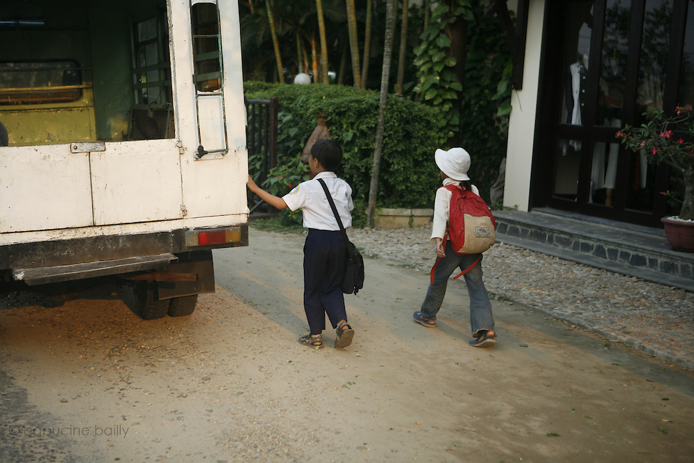 Hoi An, Vietnam. March 14th 2007..Kids come back from school.