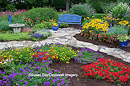 63821-21710 Blue bench, bird bath, butterfly house, blue pots, and stone path in flower garden.  Black-eyed Susans (Rudbeckia hirta) Red Dragon Wing Begonias (Begonia x hybrida)  Zinnias,  Homestead Purple Verbena (Verbena canadensis), New Gold Lantana (Lantana camara) Red Verbena, Butterfly Bushes, Sedum, zinnias, Raspberry Wine Bee Balm (Monarda didyma) Marion Co., IL