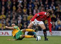 Photo. Glyn Thomas, Digitalsport<br /> Norwich City v Manchester United.<br /> Barclays Premiership. 09/04/2005.<br /> Norwich's Leon McKenzie (L) slides in with both feet against Gabriel Heinze