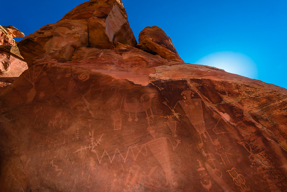 Petroglyphs at Cub Creek created by the Fremont people who lived in the area between 550 and 1200 AD. They feature human and animal figures and abstract designs. Dinosaur National Monument, Utah USA.