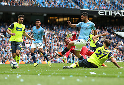 Manchester City's Sergio Aguero (right) scores his side's third goal of the game