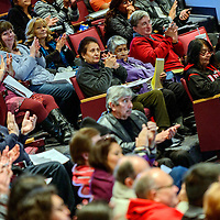 Audience members clap between speakers during a University of New Mexico - Gallup state of the university address in Gallup Monday.