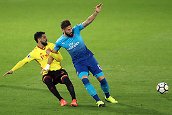14 October 2017 - Premier League Football - Watford v Arsenal - Miguel Britos of Watford pulls Olivier Giroud of Arsenal down by his arm - Photo: Charlotte Wilson / Offside
