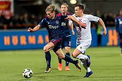 (L-R) Frenkie de Jong of Ajax, Maarten Woudenberg od ASV De Dijk during the Second Round Dutch Cup match between De Dijk and Ajax Amsterdam at Kras stadium on October 25, 2017 in Volendam, The Netherlands