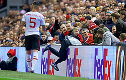 LIVERPOOL, ENGLAND - Thursday, March 10, 2016: Manchester United's Marcos Rojo helps a ball boy retrieve the ball during the UEFA Europa League Round of 16 1st Leg match against Manchester United at Anfield. (Pic by David Rawcliffe/Propaganda)